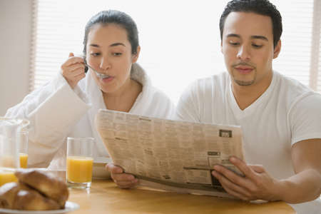 attentiveness: Hispanic couple at the breakfast table