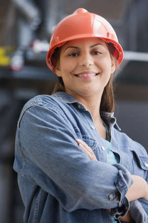 toiling: Hispanic female construction worker