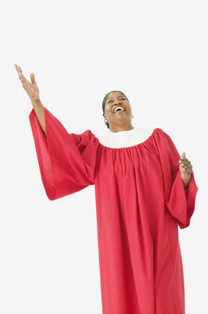 african american woman silhouette: Studio shot of senior African woman wearing a choir robe and singing