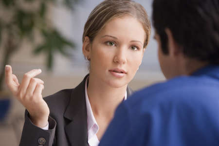 two people: Businesswoman talking to businessman