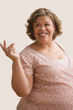 bestowing: Middle-aged overweight Hispanic woman smiling