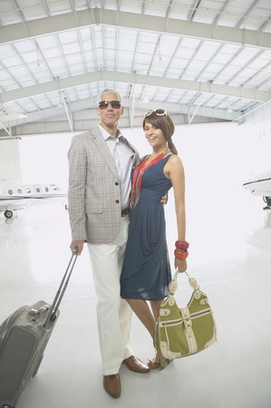 ostentatious: Couple hugging in airplane hanger, Nobato, California, United States