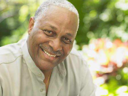 Close up of middle-aged African man smiling, Toronto, Canada Stock Photo
