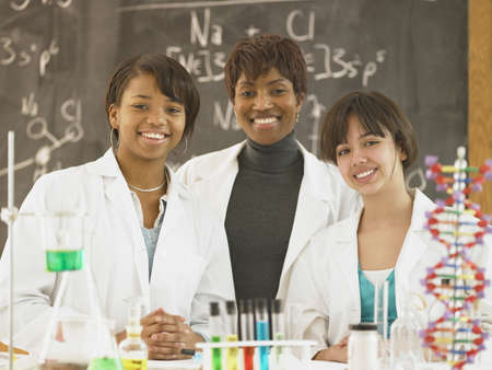 schoolroom: African female science teacher with female students
