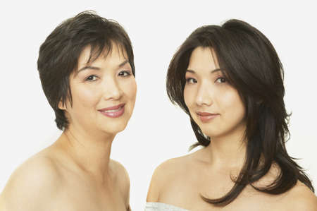 attentiveness: Studio shot of Asian mother and adult daughter smiling