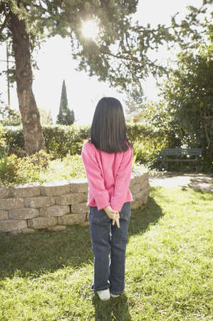 san rafael: Rear view of young Asian girl standing in the sunlight, San Rafael, California, United States LANG_EVOIMAGES