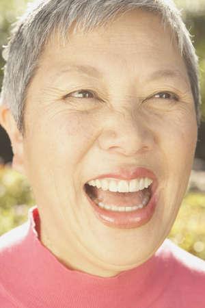 san rafael: Close up of senior Asian woman laughing, San Rafael, California, United States