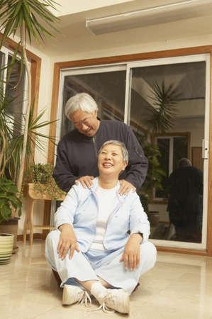 san rafael: Senior Asian couple smiling at each other, San Rafael, California, United States