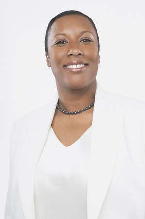 san rafael: Studio shot of African woman smiling, San Rafael, California, United States LANG_EVOIMAGES