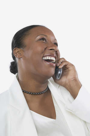 san rafael: Studio shot of African woman on her cell phone, San Rafael, California, United States