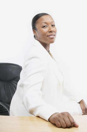 san rafael: African businesswoman at her desk, San Rafael, California, United States LANG_EVOIMAGES