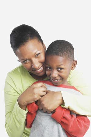 san rafael: Studio shot of African mother hugging her young son, San Rafael, California, United States