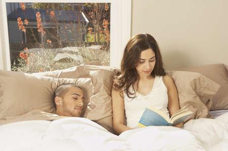 san rafael: Hispanic couple in bed, San Rafael, California, United States LANG_EVOIMAGES