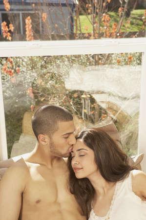 san rafael: Hispanic couple hugging and kissing, San Rafael, California, United States LANG_EVOIMAGES