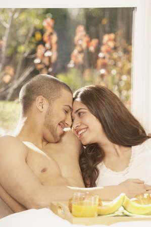 san rafael: Hispanic couple having breakfast in bed, San Rafael, California, United States