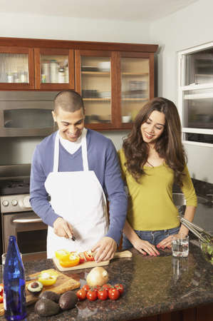 san rafael: Young Hispanic couple chopping vegetables, San Rafael, California, United States