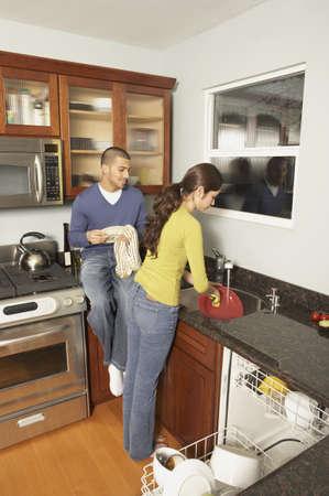 san rafael: Young Hispanic couple washing dishes, San Rafael, California, United States