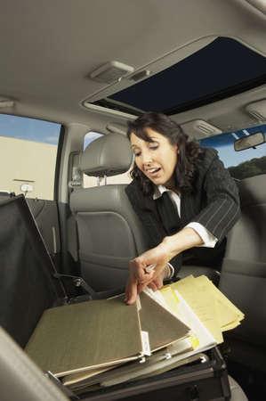 san rafael: Businesswoman getting files out of the backseat, San Rafael, California, United States LANG_EVOIMAGES
