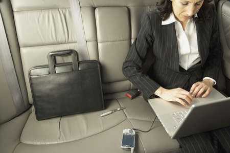 telecommuter: Businesswoman working in the backseat of a car, San Rafael, California, United States