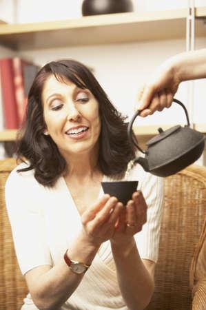 san rafael: Woman being served tea, San Rafael, California, United States