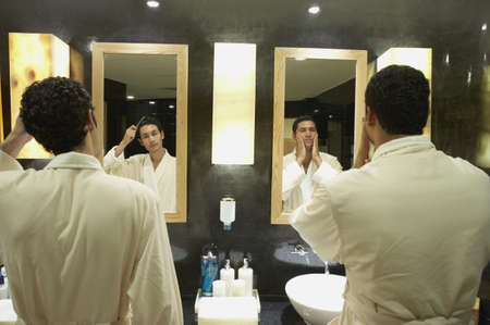 admiring: Two men in robes in front of bathroom mirrors, Los Cabos, Mexico LANG_EVOIMAGES
