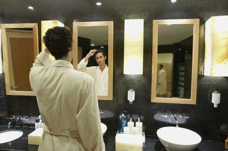bathroom mirror: Man in robe in front of bathroom mirror, Los Cabos, Mexico