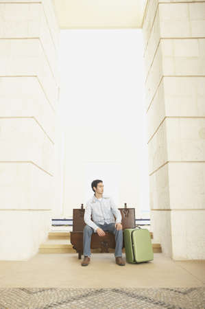los cabos: Man with suitcase sitting in open doorway, Los Cabos, Mexico
