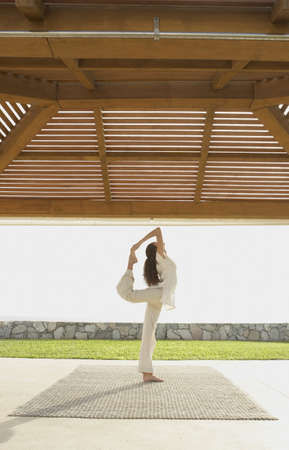 Woman doing yoga at beach resort, Los Cabos, Mexico Stock Photo