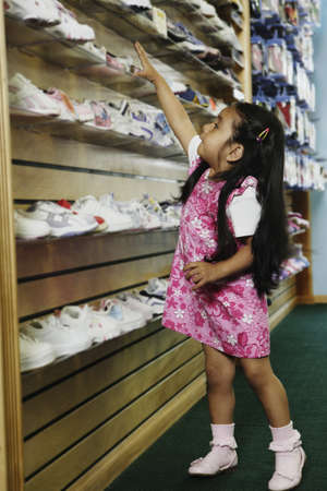 Young Hispanic girl at shoe store, Port Washington, New York, United States Stock Photo