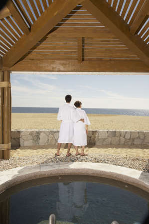 los cabos: Couple in bathrobes outdoors at beach resort, Los Cabos, Mexico