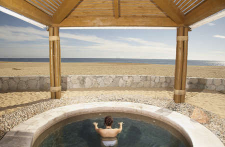 los cabos: Woman in hot tub at beach resort, Los Cabos, Mexico LANG_EVOIMAGES