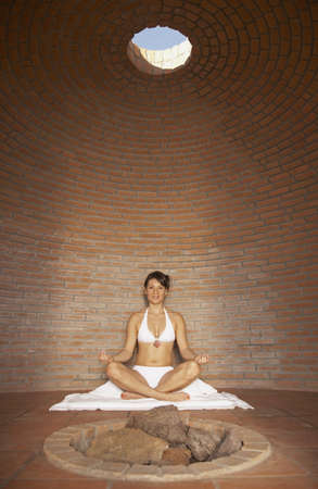 los cabos: Woman meditating in sweat lodge, Los Cabos, Mexico