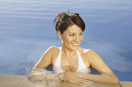 los cabos: Hispanic woman smiling in hotel pool, Los Cabos, Mexico