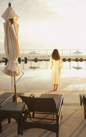 los cabos: Woman in bathrobe outdoors at resort hotel, Los Cabos, Mexico