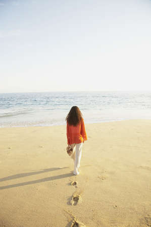 los cabos: Woman walking on the beach, Los Cabos, Mexico LANG_EVOIMAGES