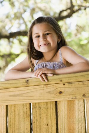 babyboomer: Young Hispanic girl smiling outdoors LANG_EVOIMAGES