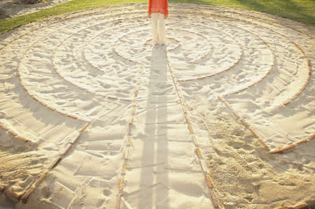 longshot: Person standing in the middle of a meditation labyrinth LANG_EVOIMAGES