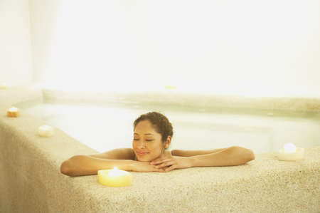 swimming candles: Woman relaxing in spa room