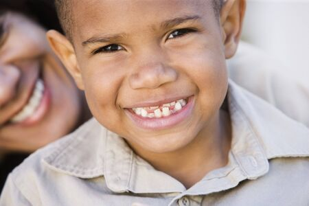 gramma: Close up of African American boy with mother