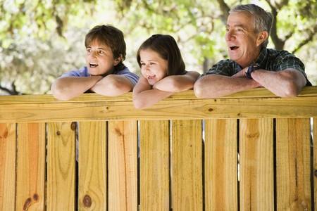 babyboomer: Hispanic family laughing outdoors LANG_EVOIMAGES