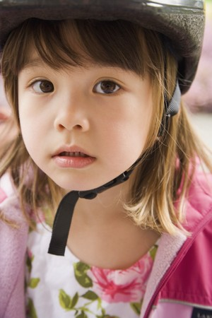 bicycle helmet: Close up of young Asian girl wearing bicycle helmet
