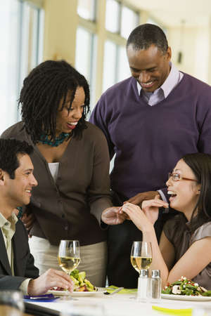 solicitous: Woman showing friends her engagement ring LANG_EVOIMAGES