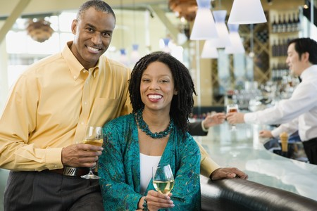 wooing: African American couple smiling at bar