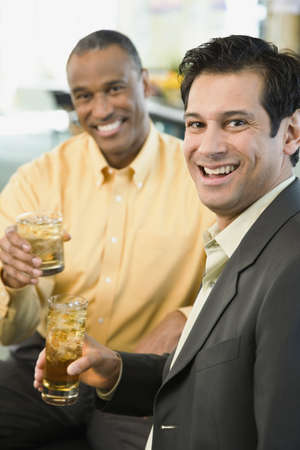 alehouse: Two men smiling with drinks