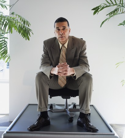 acknowledging: African American businessman sitting in chair on pedestal