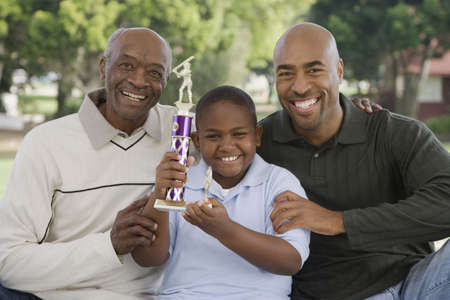 grampa: African American family with trophy outdoors LANG_EVOIMAGES