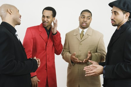 motioning: Group of African American businessmen talking