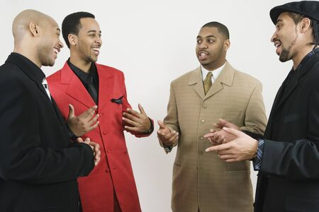 motioning: Group of African American businessmen laughing