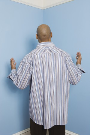 casualness: Rear view of African American man facing corner