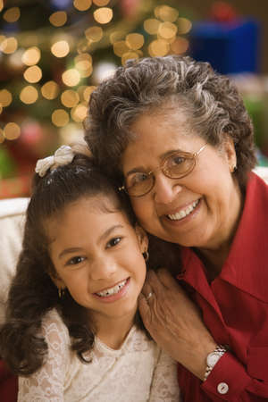 Hispanic grandmother and granddaughter smiling Stock Photo